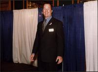 Man in a suit at the Women's Expo