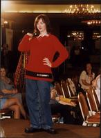 Model in a red sweater and jeans during a fashion show at the Women's Expo