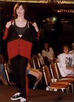 Model in a black and red track suit during a fashion show at the Women's Expo