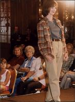 Model in plaid shirt during a fashion show at the Women's Expo