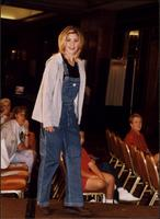 Model in bib overalls during a fashion show at the Women's Expo