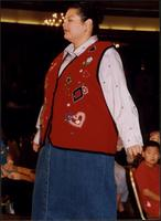 Model wearing a vest and denim skirt during a fashion show at the Women's Expo