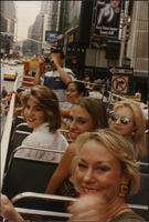 Melissa Stevens and a group of students on a tour bus in New York City