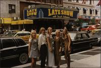 Melissa Stevens and a group of students posing for a photo in front of the marquee for the Late Show