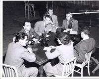 Al Jarvis and Dave Dexter with several unidentified people seated at studio table