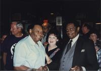 "Jay McShann and Al ""Delightful De"" Bartee with an unidentified woman"