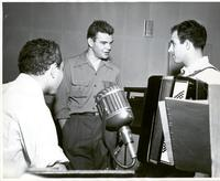 Dave Dexter with two unidentified musicians