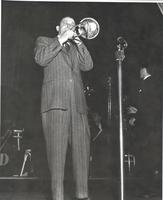 Tommy Dorsey playing trombone on stage