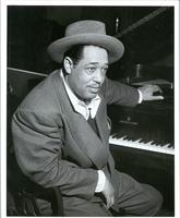 Duke Ellington seated at piano.
