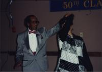 Billie G. Moore, Jr., dancing with an unidentified woman