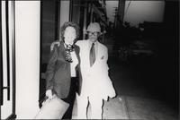 Betty Crow and Billy G. Moore, Jr., on a sidewalk