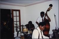 Musicians performing at a house party
