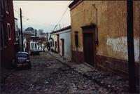 Buildings along a cobble-stone road in Oaxaca