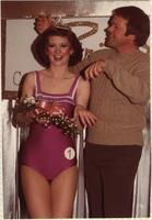 Melanie Derr, Miss Boating 1982, laughing as she is being crowned by an unidentified man