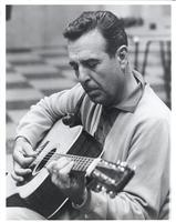 Tennessee Ernie Ford playing guitar