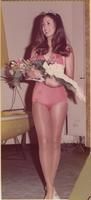 Contestant (32), the 1975 Boating Queen, looks to her right while holding a bouquet during the K.C. Boat, Sports & Travel Show