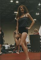 One-piece black and white swimsuit with a blousy top during the Boat Show Fashion Show