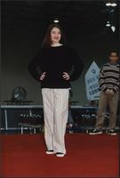 Black sweater and striped pants at the Boat Show Fashion Show