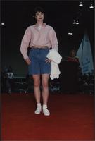 Jean shorts and white tennis shoes during the Boat Show Fashion Show