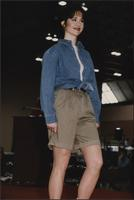 Stevens model wearing a denim shirt and khaki shorts during the Boat Show Fashion Show