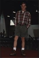 male model wears cargo shorts and hiking boots during the Boat Show Fashion Show