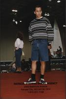 Jay Boothman wearing jeans shorts and a sweater during the Boat Show Fashion Show