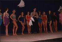 Ten women and one male Stevens models look to their left as they stand in a line during the Boat Show Fashion Show