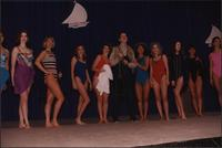 Ten women and one male Stevens models stand in a line during the Boat Show Fashion Show
