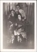 Lawrence, Minnie, and Martha Jane McLean around a chair