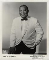 Publicity photo of Jay McShann in a white jacket