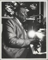 Photo of Jay McShann playing the piano