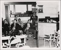Jay McShann playing piano with a band