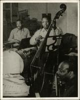 Count Basie, Jo Jones and Walter Page performing