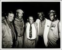Jay McShann posing for a photo with four others
