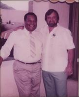 Jay McShann posing for a photo with unidentified man