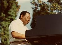 Jay McShann playing piano outside