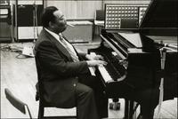 Jay McShann smoking while playing piano