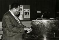 Jay McShann playing piano on stage in Europe