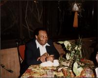 Jay McShann at a restaurant or bar table