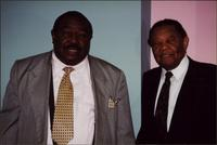 Jay McShann with Floyd Dixon in a gray suit