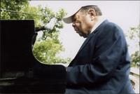 Jay McShann playing piano outdoors