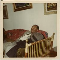 Jay McShann resting on a couch
