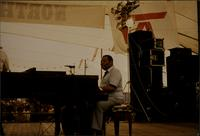 Jay McShann playing piano during an outdoor concert