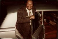 Jay McShann getting out of the back seat of a car