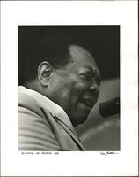 Portrait of Jay McShann singing and playing at the 1980 Monterey Jazz Festival