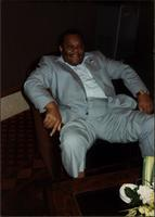 Jay McShann relaxing in a chair