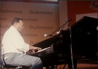 Jay McShann playing piano on stage in Japan