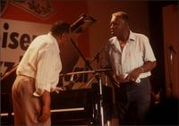 Jay McShann speaking with Joe Williams on stage in Japan