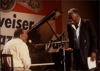 Jay McShann laughing on stage with Joe Williams in Japan
