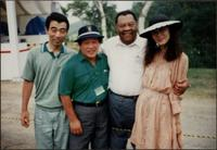Jay McShann posing for a photo with three unidentified Japanese people